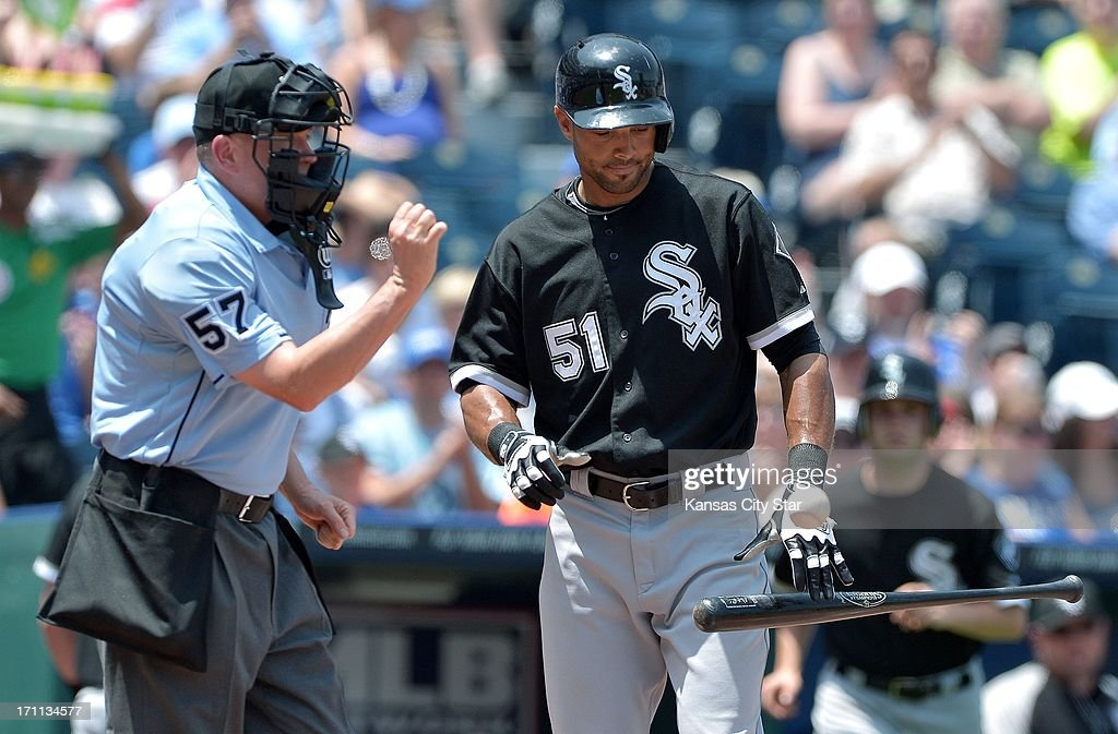 The Chicago White Sox's Alex Rios (51) throws his bat down as home plate umpire Mike Everitt calls him out looking at strike three to end the top of the third inning against the Kansas City Royals at Kauffman Stadium in Kansas City, Missouri, Saturday, June 22, 2013.