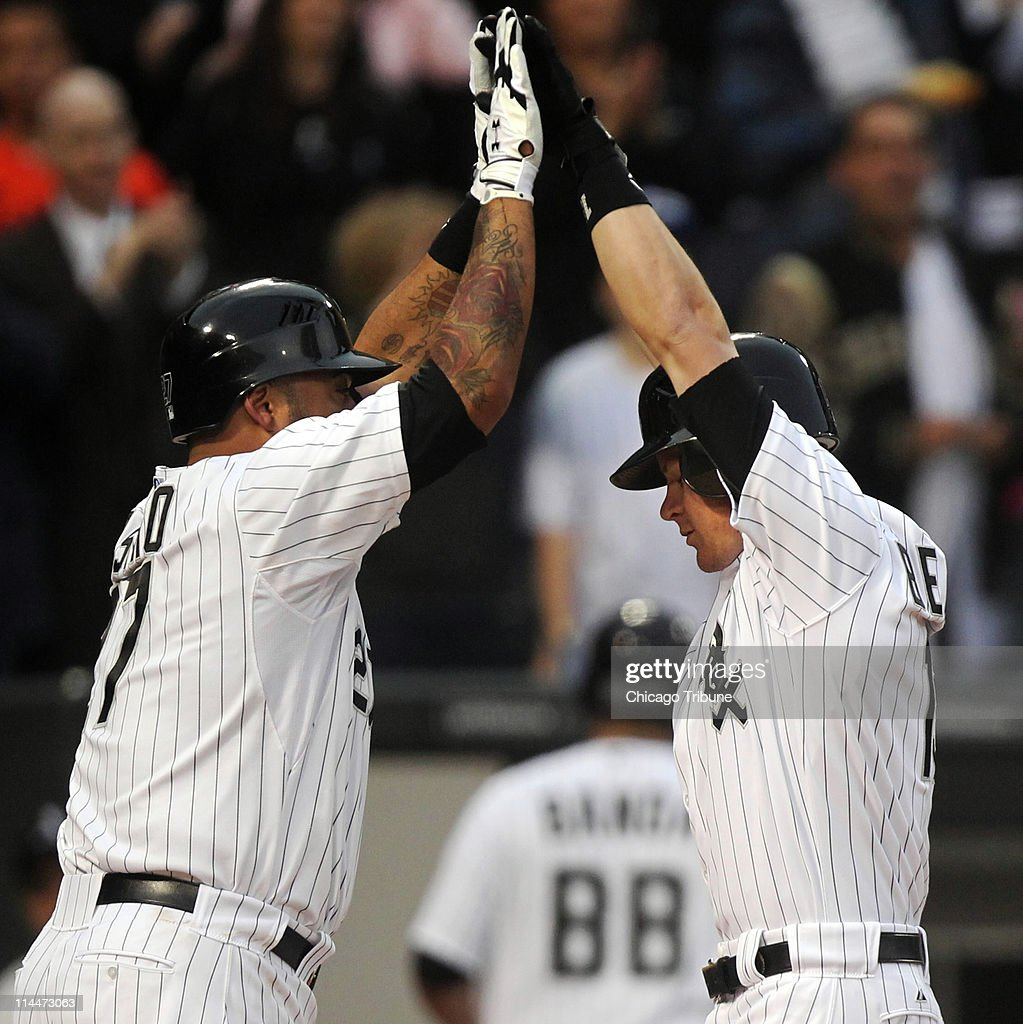 The Chicago White Sox's Gordon Beckham, right, is congratulated by teammate Ramon Castro after hitting a two-run home run in the second inning against the Los Angeles Dodgers at U.S. Cellular Field in Chicago, Illinois, Friday, May 20, 2011.