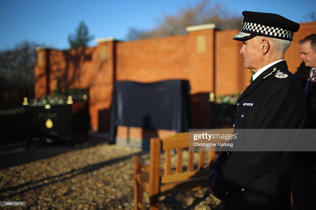 The Chief Constable of Greater Manchester Police, Peter Fahy, pauses for thought in the memorial garden dedictated to murdered PC's Fiona Bone and Nicola Hughes, which was unveiled today on December 13, 2012 in Hyde, England. Police Constables Fiona Bone, 32, and her colleague Nicola Hughes, 23, were killed as they responded to what they thought was a routine burglary call in Mottram, Greater Manchester and were murdered in a gun and grenade attack. The memorial garden outside Hyde police station has been created using funds donated by the public, businesses and police partners.