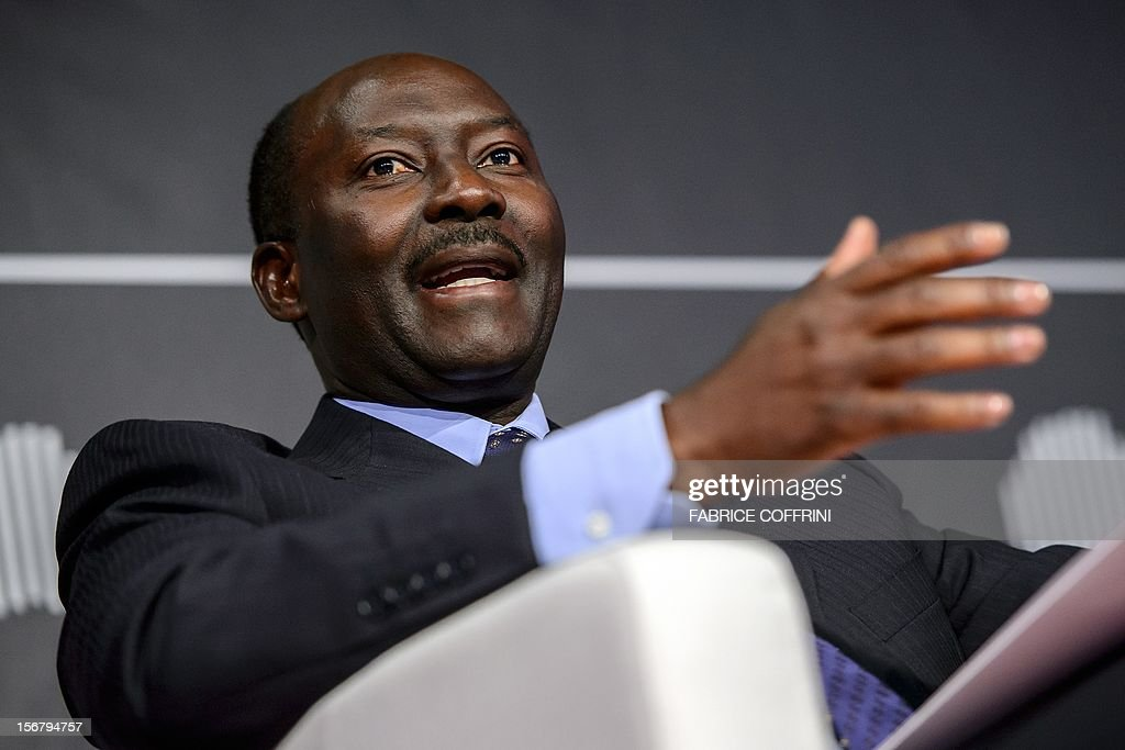 The chief executive officer of the Gabon-headquartered BGFIBank, Henri-Claude Oyima, gestures on November 21, 2012 during the 'What development strategies should African companies employ?' plenary session at the first Africa CEO Forum in Geneva. AFP PHOTO / FABRICE COFFRINI