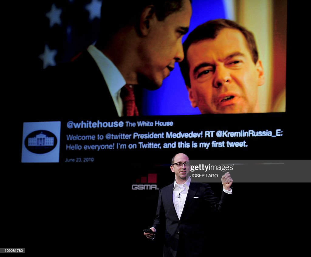 The chief executive officer of Twitter, Dick Costolo speaks as Russian President Dmitry Medvedev and US President Barack Obama are seen on a screen behind him on February 14, 2011 during the opening of the 3GSM World Congress in Barcelona. The 2011 Mobile World Congress will be held from February 15 to 17 in Barcelona.
