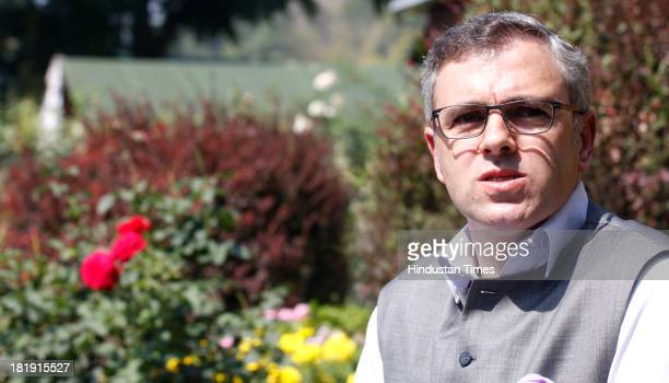 The Chief Minister of Jammu and Kashmir Omar Abdullah addressing a press conference at his residence on September 26 2013 in Srinagar India...
