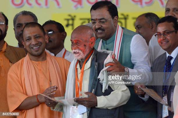 The Chief Minister of the Indian state of Uttar Pradesh Yogi Adityanath gives a certificate to a farmer to clear his loans under the Uttar Pradesh...