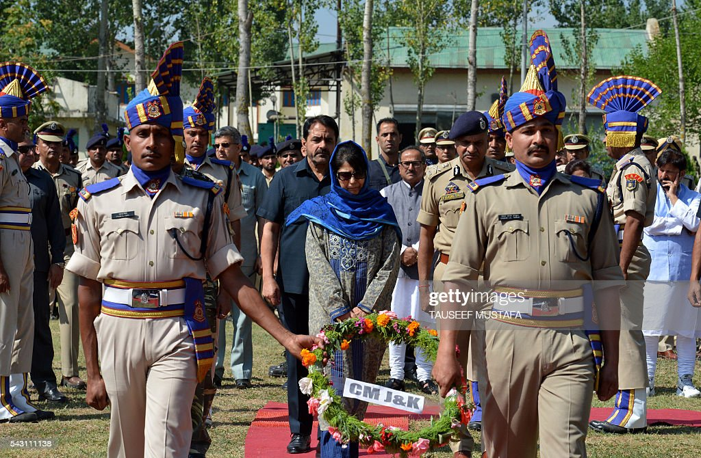 The Chief Minister of the state of Jammu and Kashmir Mehbooba Mufti (C) takes part in a ceremony for eight Indian paramilitary soldiers killed in an ambush in Srinagar on June 26, 2016. At least eight Indian paramilitary soldiers and two suspected rebels were killed June 25 near Srinagar in India-administered Kashmir when a group of armed militants ambushed the soldiers' convoy, police said. Four militants sprayed bullets on the convoy carrying members of India's Central Reserve Police Force (CRPF) near Pampore town, killing five soldiers instantly and wounding 20, inspector general of police for the region, Javaid Gillani, told AFP. / AFP / TAUSEEF