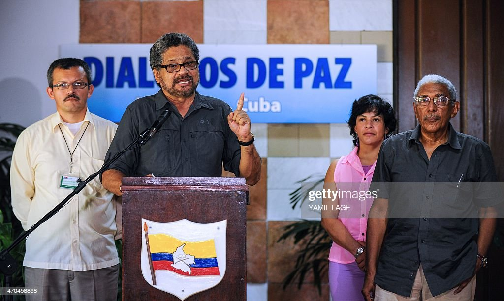 The chief negotiator of the FARC-EP leftist guerrilla delegation, commander Ivan Marquez (2-L), speaks during a press conference at the end of the 35th cycle of the peace talk between the Colombian government and the Revolutionary Armed Forces of Colombia, at Convention Palace in Havana, on April 20, 2015. Colombia's leftist FARC guerrillas said Monday they will maintain their unilateral ceasefire despite a recent clash with the army, except if their fighters come under siege. The two-year-old peace process suffered a setback last week when the rebels killed 11 soldiers in what the army called an unprovoked attack. AFP PHOTO / Yamil LAGE