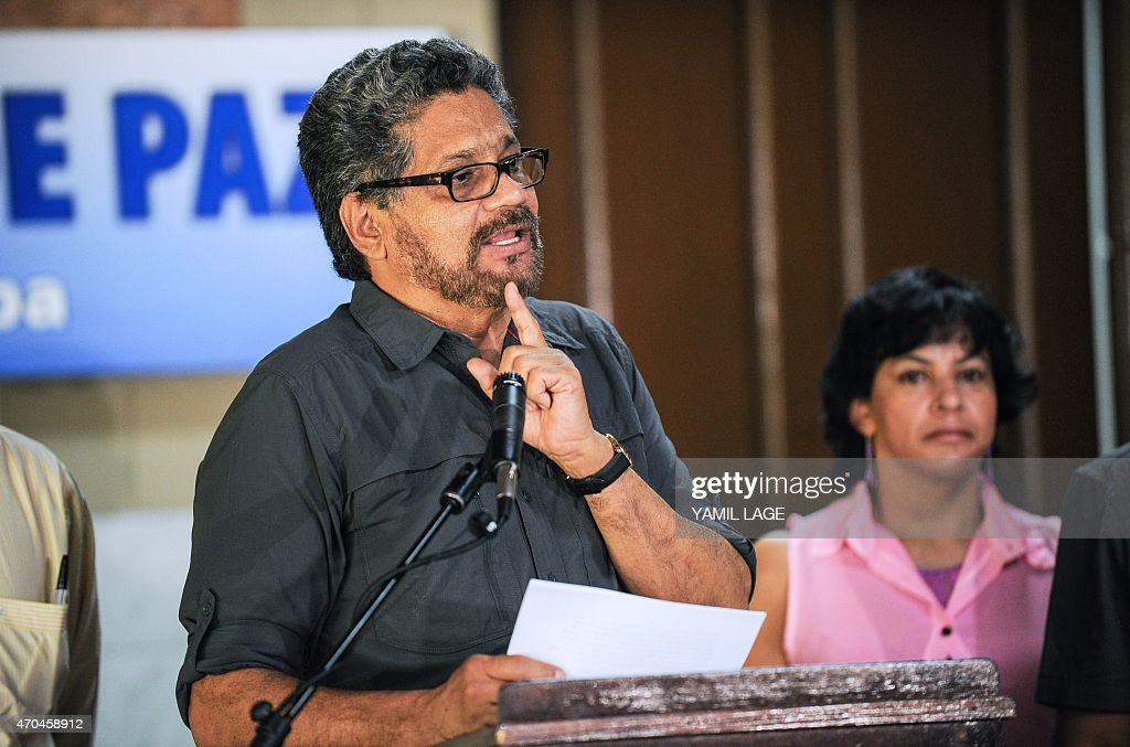 The chief negotiator of the FARC-EP leftist guerrilla delegation, commander Ivan Marquez, speaks during a press conference at the end of the 35th cycle of the peace talk between the Colombian government and the Revolutionary Armed Forces of Colombia, at Convention Palace in Havana, on April 20, 2015. Colombia's leftist FARC guerrillas said Monday they will maintain their unilateral ceasefire despite a recent clash with the army, except if their fighters come under siege. The two-year-old peace process suffered a setback last week when the rebels killed 11 soldiers in what the army called an unprovoked attack. AFP PHOTO / Yamil LAGE