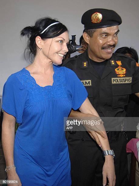 The Chief of Kerobokan Prison Ilham Jaya holds Australian Schapelle Corby inside Kerobokan prison during a press visit in Denpasar on March 11 2008...