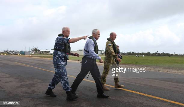The chief of the defence force Air Chief Marshal Mark Binskin walks with Australian Prime Minister Malcolm Turnbull and Brigadier Chris Field as they...