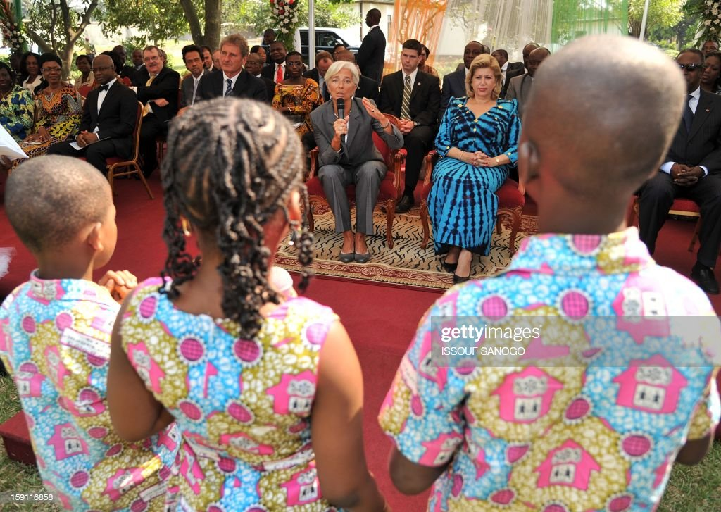 The chief of the International Monetary Fund, Christine Lagarde (C) delivers a speech next to Ivory Coast first lady Domonique Ouattara (R) durin a visit at an orphanage village in Abobo, suburb of Abidjan on January 8, 2013. Lagarde, called for 'a second Ivorian economic miracle' during a visit to Abidjan as part of an African tour.