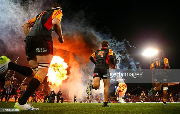 The Chiefs run out on the field for the Super Rugby Final match between the Chiefs and the Brumbies at Waikato Stadium on ugust 3 2013 in Hamilton...