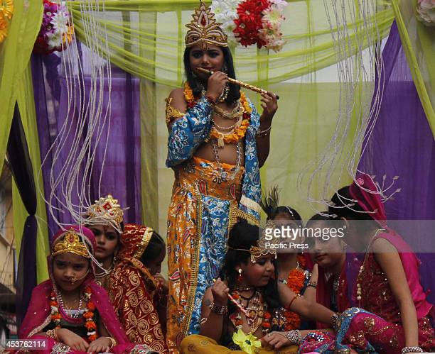 The children dressed as Hindu God Krishna join in a procession before the 'Janmashtami Festival' in Jammu