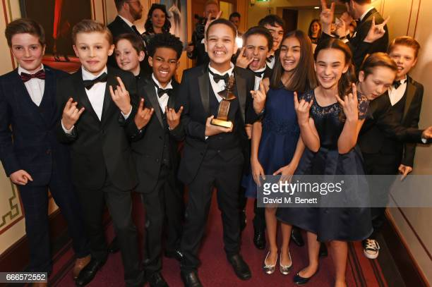 The children from 'School Of Rock The Musical' winners of the Outstanding Achievement In Music award pose in the winners room at The Olivier Awards...