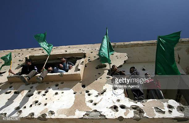 The children hold flags as members of the Hamas movement perform the friday prayer with the aim of demanding the abandon of Egypt's blockade at the...