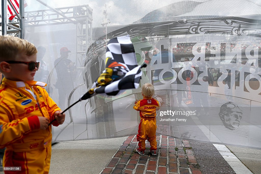 The children of driver Ryan Hunter-Reay play before the 100th Running of the Indianapolis 500 Mile Race at Indianapolis Motorspeedway on May 29, 2016 in Indianapolis, Indiana.