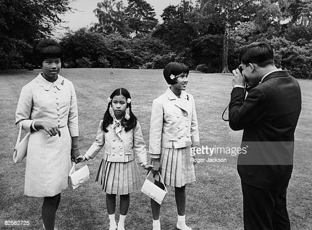 The children of King Bhumibol and Queen Sirikit of Thailand play with a camera at King's Beeches their private residence in Sunninghill Berkshire...
