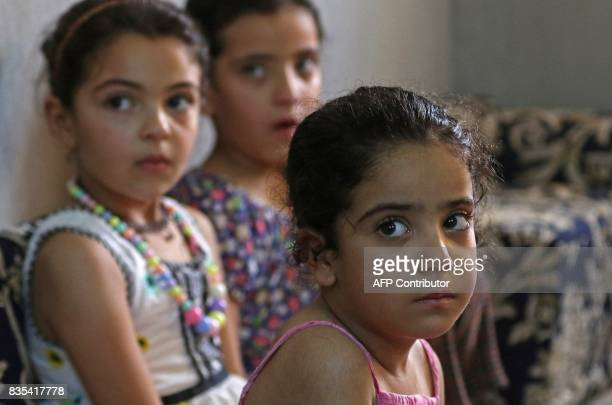 The children of Syrian refugee Mohamed Ghazal sit in a home in the northern Jordanian city of Irbid where they are being housed under a programme...