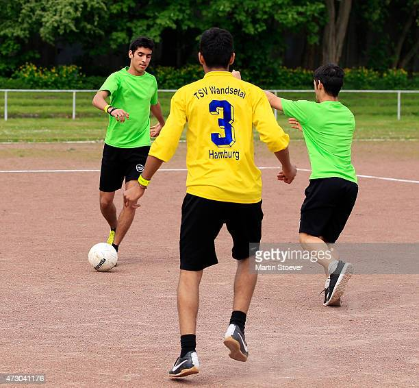 The children of the TSV Wandsetal plays the ball during the visit of Minister Of State For Migration Refugees And Integration Aydan Oezoguz May 12...