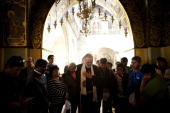 The Chilean miners who survived a 69day ordeal trapped in a cavedin gold and copper mine in Chile pray during a visit to the Church of the Holy...