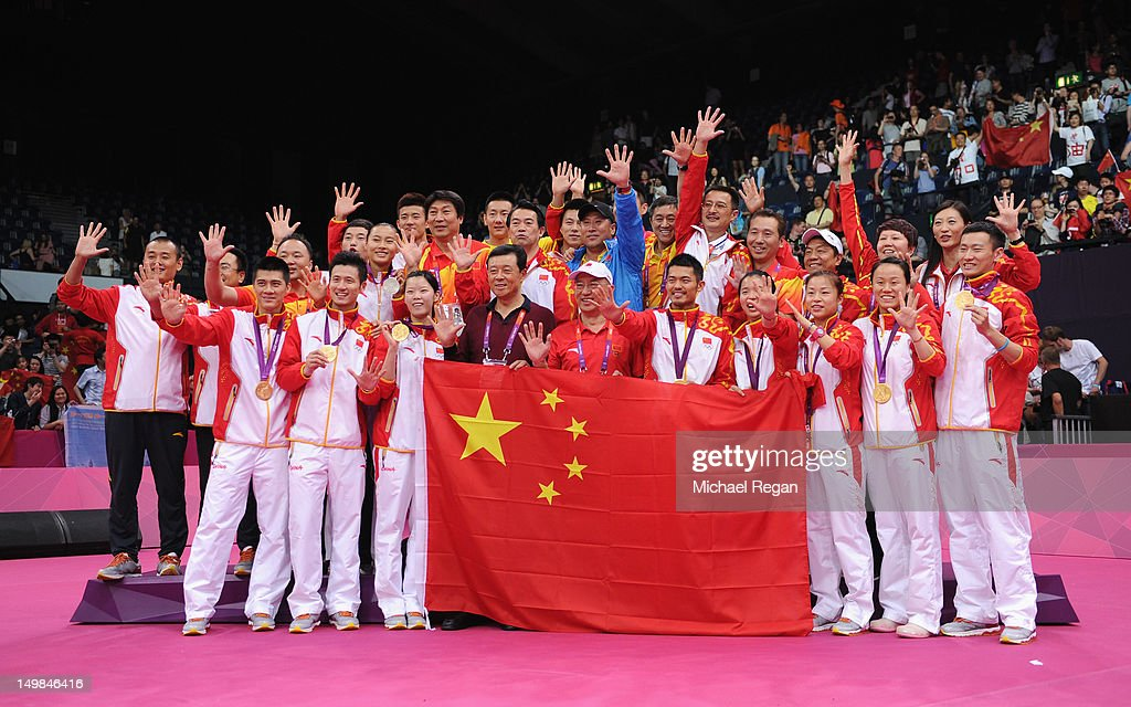 The China Badminton team celebrate their 5 Gold Medals following the Men's Doubles Badminton Gold Medal match on Day 9 of the London 2012 Olympic Games at Wembley Arena on August 5, 2012 in London, England.