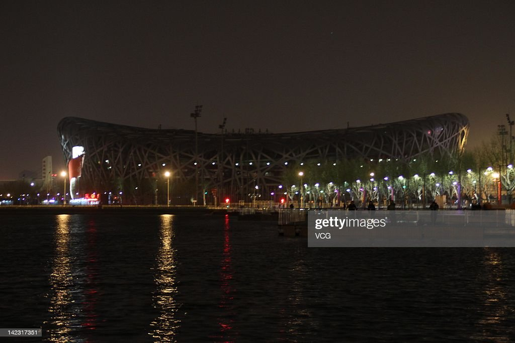 The China National stadium, also known as the Bird's Nest, is seen during the Earth Hour 2011 power switch off on March 31, 2012 in Beijing, China. About 124 Chinese cities joined a WWF worldwide initiative Earth Hour this year.