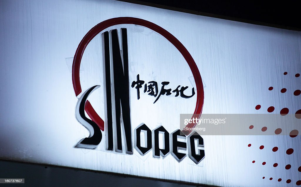 The China Petroleum & Chemical Corp. (Sinopec) logo is illuminated at night at a gas station in Shanghai, China, on Wednesday, Jan. 30, 2013. Sinopec, Asia's biggest refiner, will raise HK$24 billion ($3.1 billion) in its biggest share sale since listing in 2000 as it looks to add production assets. Photographer: Tomohiro Ohsumi/Bloomberg via Getty Images