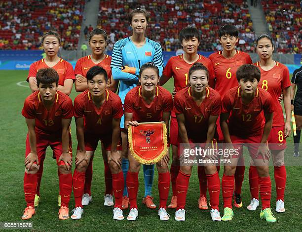 The China PR players pose for a team photograph prior to the Women's First Round Group E match between China PR and Sweden on Day 4 of the Rio 2016...
