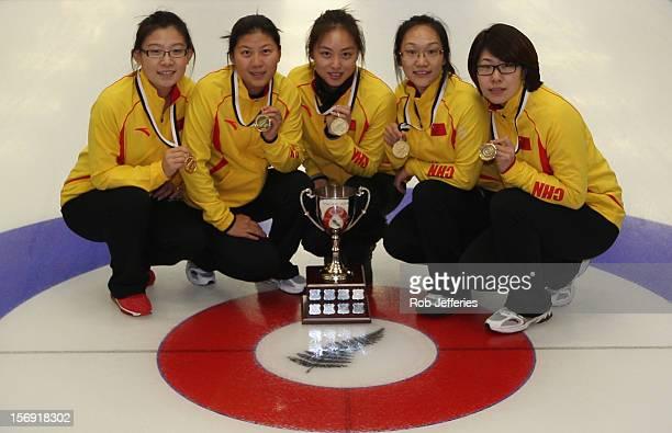 The China team of Bingyu Wang Yin Liu Qingshuang Yue Yan Zhou and Jinli Liu pose for a photo during the Pacific Asia 2012 Curling Championship at the...