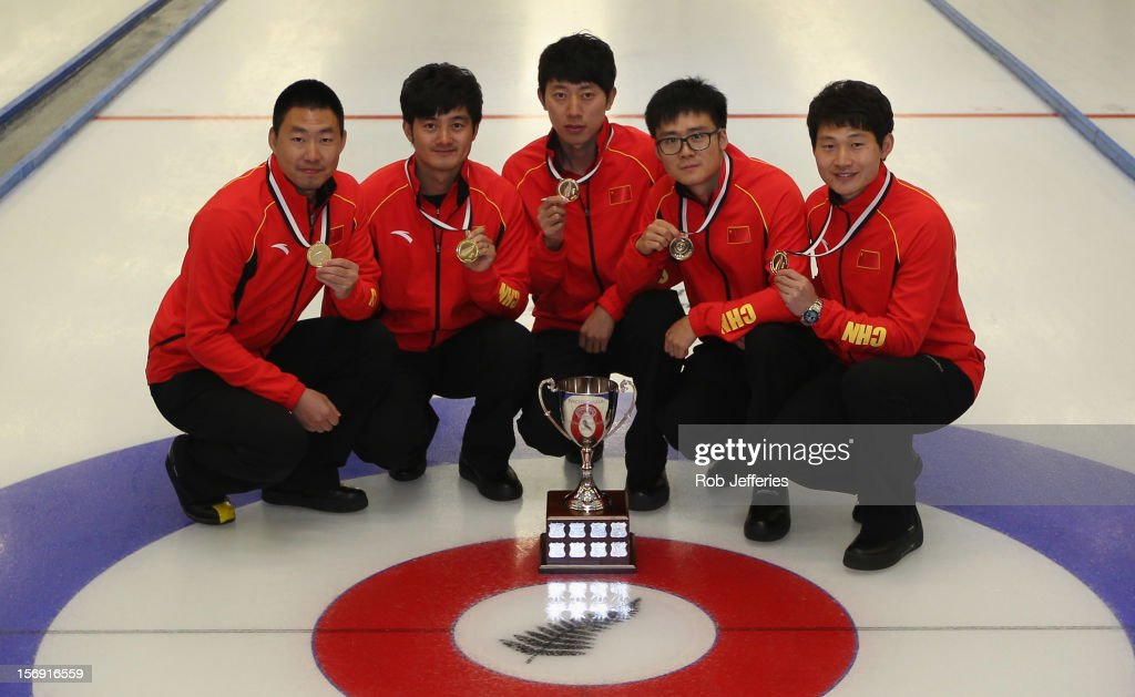 The China team of Rui Liu, Xiaoming Xu, Jialiang Zang, Dexin Ba and Dejia Zou pose for a photo during the Pacific Asia 2012 Curling Championship at the Naseby Indoor Curling Arena on November 25, 2012 in Naseby, New Zealand.