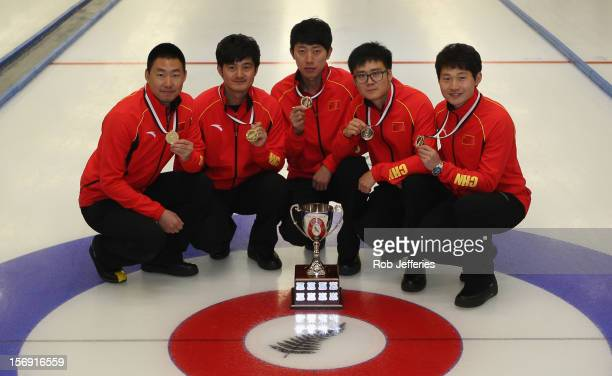 The China team of Rui Liu Xiaoming Xu Jialiang Zang Dexin Ba and Dejia Zou pose for a photo during the Pacific Asia 2012 Curling Championship at the...