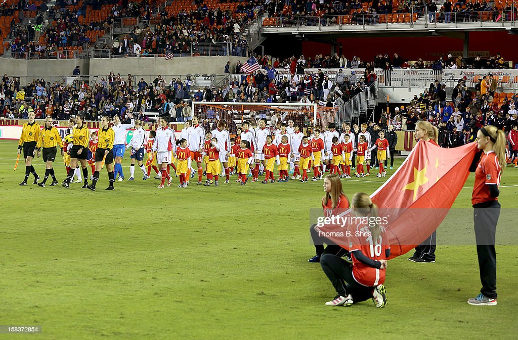 The China Women's National Team enters the pitch before playing against the U.S. Women's National Team in an international friendly game at BBVA Compass Stadium on December 12, 2012 in Houston, Texas. USA won 4 to 0.