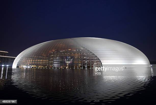The China's National Grand Theater is illuminated during the opening ceremony of 4th Beijing International Film Festival on April 16 2014 in Beijing...