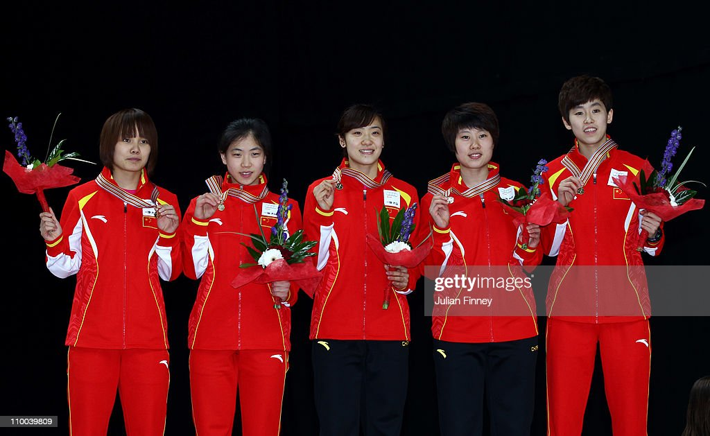 The Chinese 3000m relay team, Kexin Fan, Jianrou Li, Qiuhong Liu, Hui Zhang with their gold medals during day three of the ISU World Short Track Speed Skating Championships at Sheffield Arena on March 13, 2011 in Sheffield, England.