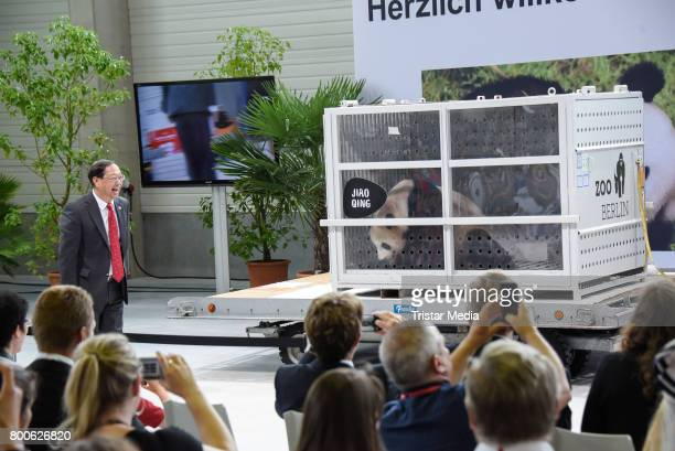 The chinese ambassador Shi Mingde and the male Panda Jiao Qing at airport Berlin Tegel on June 24 2017 in Berlin Germany