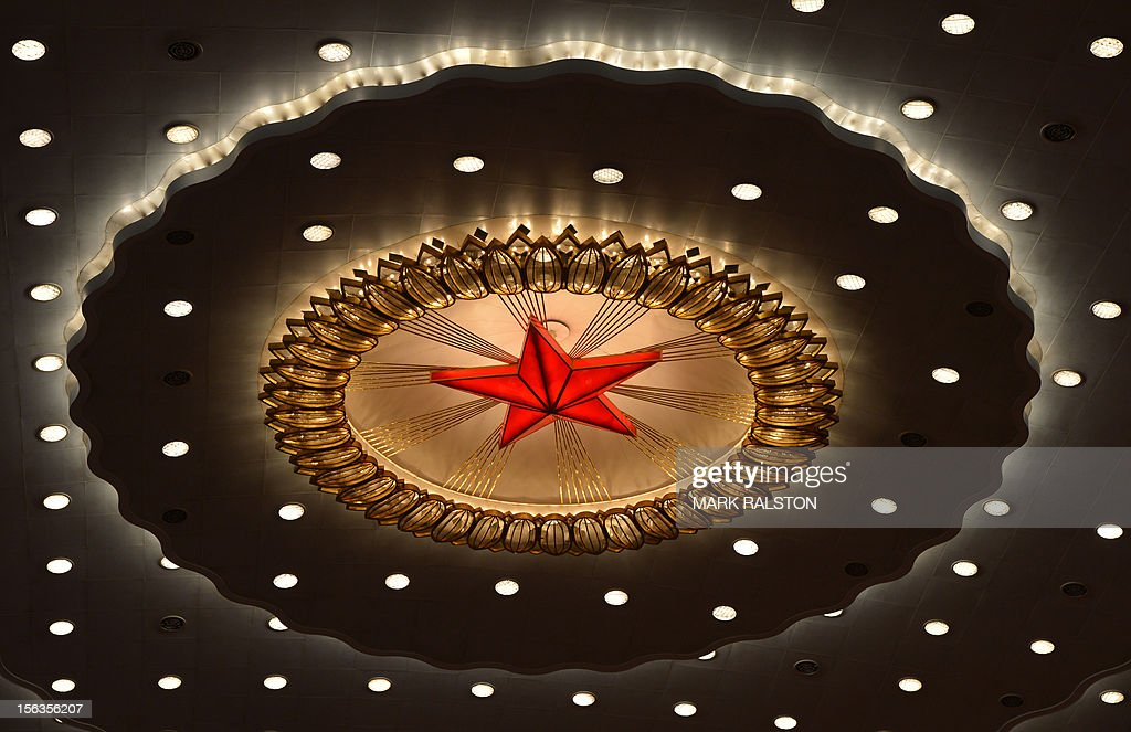 The Chinese Communist star emblem during the closing ceremony of the Party Congress at the Great Hall of the People in Beijing on November 14, 2012. China's Communist Party will on November 15 unveil the new set of top leaders who will run the country for the next decade, one day after its week-long congress ends. AFP PHOTO/Mark RALSTON
