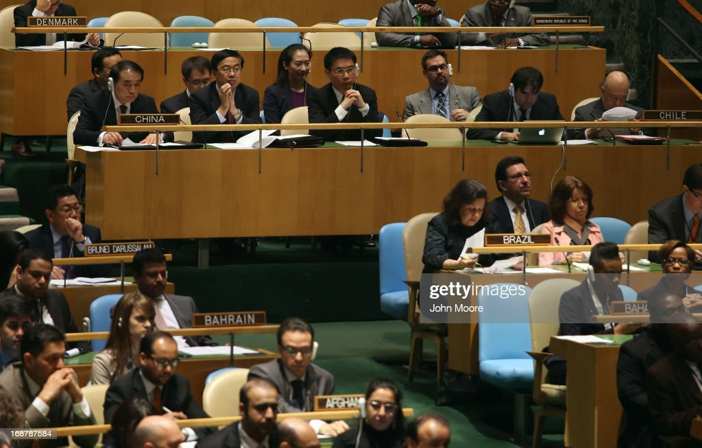 The Chinese delegation listens during speeches ahead of a vote at the United Nations calling for a political transition in Syria on May 15, 2013 in New York City. The 193-member UN General Assembly was to vote on an Arab-backed resolution condemning the regime of Syrian President Bashar Assad for human rights abuses and its escalating use of heavy weapons in the country's civil war.