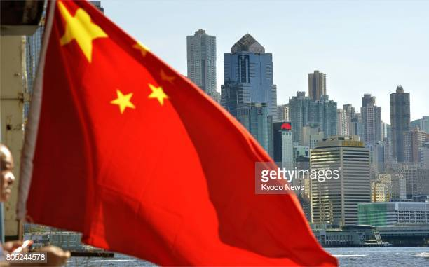 The Chinese flag flies in Hong Kong on June 30 on the eve of the 20th anniversary of the former British colony's handover to China ==Kyodo