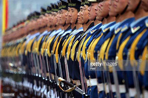 The Chinese honor guard awaits inspection during the welcome ceremony for US Chairman of the Joint Chief of Staff Marine Gen Peter Pace at the...