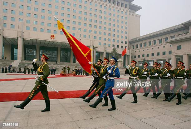 The Chinese honor guard marches during the welcome ceremony for US Chairman of the Joint Chiefs of Staff Marine Gen Peter Pace at the Defense...