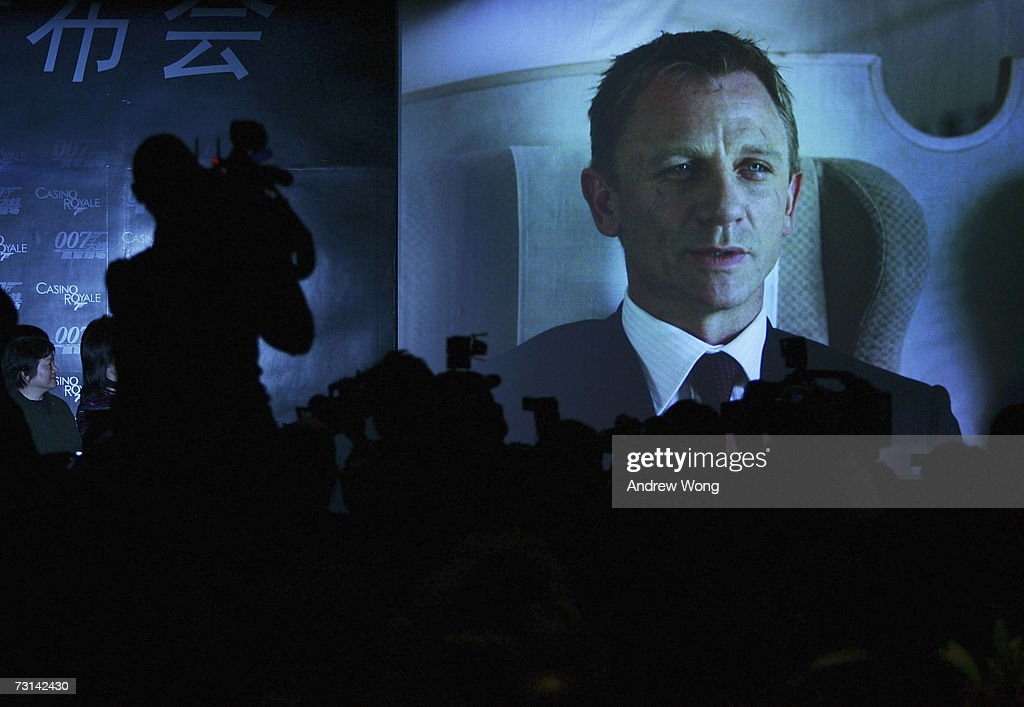 The Chinese media watch a trailer from the film during a news conference before the Chinese premiere of the new James Bond film 'Casino Royale', on January 29, 2007 in Beijing, China. Casino Royale is the the first film of the James Bond series to premiere in China.