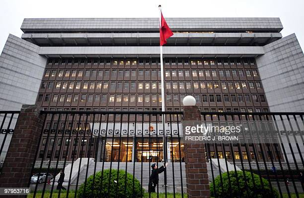 The Chinese national flag is raised in front of the Shanghai No1 Intermediate People's Court in Shanghai on March 23 2010 where the diplomatically...