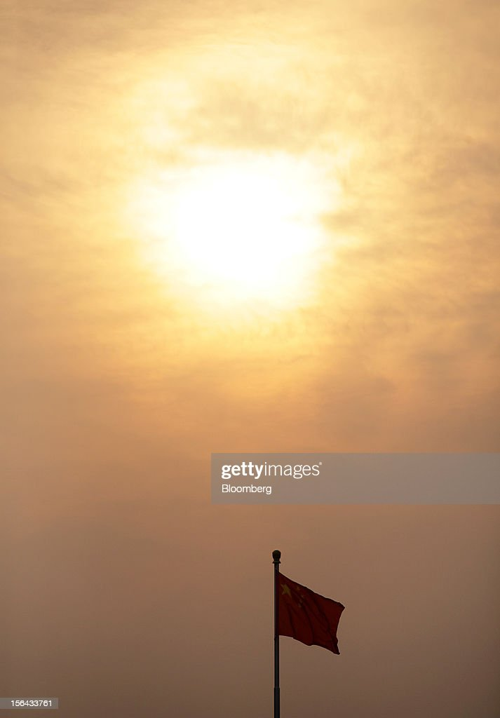 The Chinese national flag is seen flying at dusk in Beijing, China, on Thursday, Nov. 15, 2012. Xi Jinping replaced Hu Jintao as head of the Chinese Communist Party and the nation's military, ushering in the fifth generation of leaders who are set to run the world's second-biggest economy over the next decade. Photographer: Tomohiro Ohsumi/Bloomberg via Getty Images