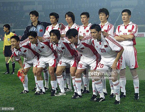 The Chinese national soccer team poses before its 2002 FIFA World Cup qualifying match against Oman 07 October 2001 in Shenyang AFP PHOTO/Frederic J...