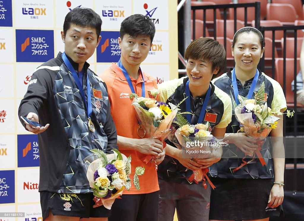 The Chinese pairs of <a gi-track='captionPersonalityLinkClicked' href=/galleries/search?phrase=Xu+Xin+-+Table+Tennis+Player&family=editorial&specificpeople=15781496 ng-click='$event.stopPropagation()'>Xu Xin</a> and Ma Long, and <a gi-track='captionPersonalityLinkClicked' href=/galleries/search?phrase=Ding+Ning+-+Table+Tennis+Player&family=editorial&specificpeople=2161349 ng-click='$event.stopPropagation()'>Ding Ning</a> and Li Xiaoxia pose for a photo after winning the men's and women's doubles titles, respectively, at the International Table Tennis Federation (ITTF) World Tour Japan Open in Tokyo on June 19, 2016.