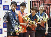 The Chinese pairs of Xu Xin and Ma Long and Ding Ning and Li Xiaoxia pose for a photo after winning the men's and women's doubles titles respectively...
