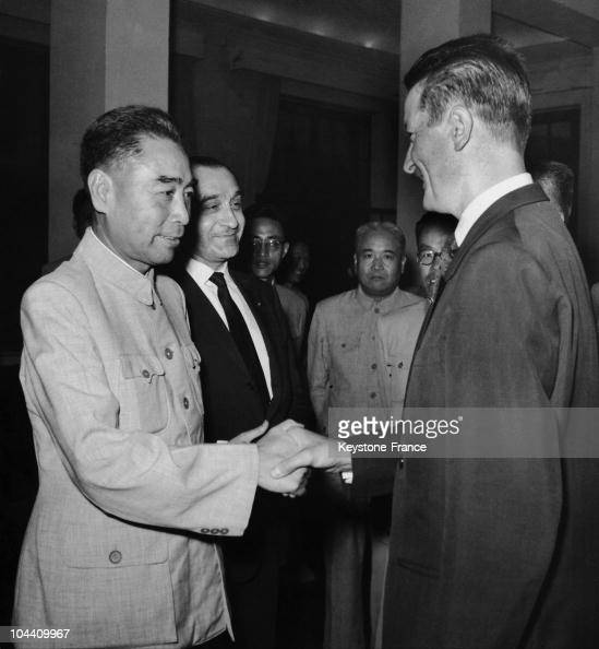 The Chinese Prime Minister ZHOU ENLAI shaking hands with the French deputy Roland DUMAS during a reception in Peking on August 10 1958
