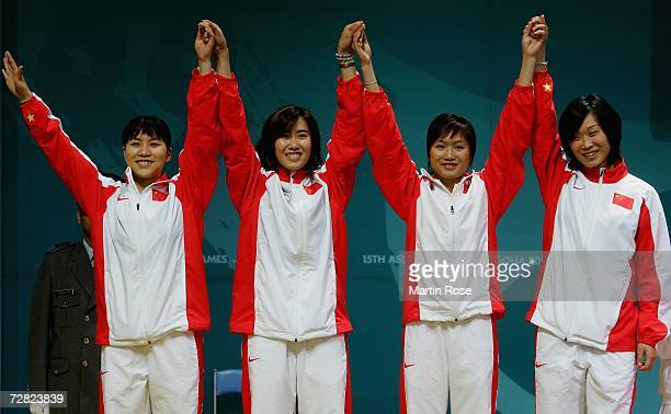 The Chinese team celebrates their silver medal in the Women's Team Foil Gold Medal match during the 15th Asian Games Doha 2006 at the AlArabi Indoor...