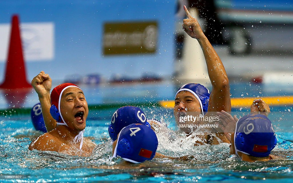 The Chinese water polo team celebrates winning the gold medal in the final of the men's water polo championship against Kazakhstan at the 9th Asian Swimming Championships in Dubai, on November 25, 2012. China won 4-2 in a penalty shoot-out after a 9-9 draw at the final whistle. AFP PHOTO/MARWAN NAAMANI