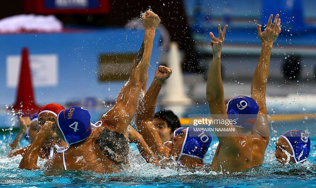 The Chinese water polo team celebrates winning the gold medal in the final of the men's water polo championship against Kazakhstan at the 9th Asian Swimming Championships in Dubai, on November 25, 2012. China won 4-2 in a penalty shoot-out after a 9-9 draw at the final whistle.