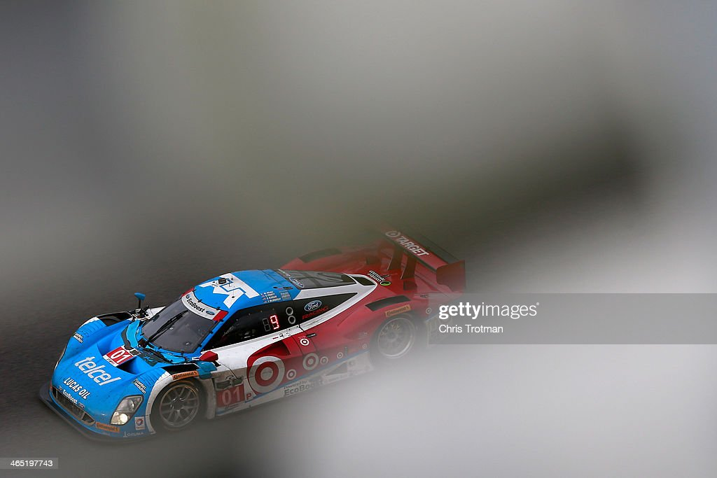 The #01 Chip Ganassi Racing Telcel/Target Riley DP driven by <a gi-track='captionPersonalityLinkClicked' href=/galleries/search?phrase=Scott+Pruett&family=editorial&specificpeople=541449 ng-click='$event.stopPropagation()'>Scott Pruett</a>, <a gi-track='captionPersonalityLinkClicked' href=/galleries/search?phrase=Memo+Rojas&family=editorial&specificpeople=3547976 ng-click='$event.stopPropagation()'>Memo Rojas</a>, <a gi-track='captionPersonalityLinkClicked' href=/galleries/search?phrase=Jamie+McMurray&family=editorial&specificpeople=198964 ng-click='$event.stopPropagation()'>Jamie McMurray</a> and Sage Karem races during the Rolex 24 at Daytona International Speedway on January 26, 2014 in Daytona Beach, Florida.