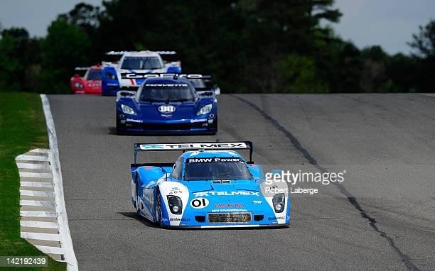 The Chip Ganassi Racing with Felix Sabates BMW Riley of Memo Rojas and Scott Pruett lead the Spirit of Daytona Corvette of Antonio Garcia and Richard...